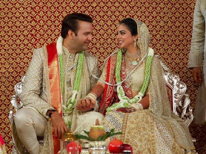 Bride Isha Ambani, the daughter of the Chairman of Reliance Industries Mukesh Ambani, and her groom Anand Piramal, heir to a real-estate and pharmaceutical business, after they got married in Mumbai, India, December 12, 2018. Reliance Industries/Handout via REUTERS  ATTENTION EDITORS - THIS IMAGE WAS PROVIDED BY A THIRD PARTY. NO RESALES. NO ARCHIVE.