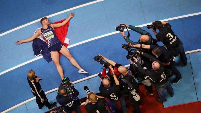 Ini adalah ekspresi kemenangan atlet heptathlon asal Prancis, Kevin Myer, saat memenangi medail emas di kejuaraan dunia atletik indoor 2018. (Hannah McKay/Reuters)