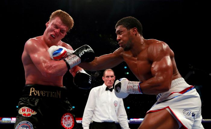 Anthony Joshua in action against Alexander Povetkin during boxing WBA Super, IBF, WBO & IBO World Heavyweight Titles at Wembley Stadium, London, Britain, September 22, 2018. Action Images via Reuters/Andrew Couldridge  SEARCH