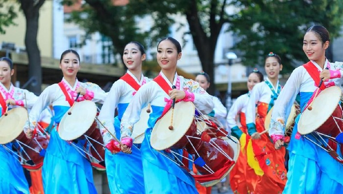 Veliko Tarnovo, Bulgaria- July 25, 2015: South Korean group for traditional music make performance in Veliko Tarnovo. South Korean group in traditional costumes plays traditional drum music on International Folklore Festival Veliko Tarnovo. The festival  is a prestigious folklore event which became significant and traditional part of the cultural life of the ancient capital of Bulgaria. A real long – expected holiday for habitants and guests of the city in the hot summer days. Today, Veliko Tarnovo is the center of one of the largest urban areas in Bulgaria.