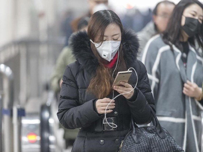 VANCOUVER, BRITISH COLUMBIA - APRIL 4:  Reporter Wendy Luo holds up a N95 mask manufactured by 3M, one of the only masks that guards against germs such as severe acute respiratory syndrome (SARS) April 4, 2003 in Vancouver, British Columbia, Canada. A SARS clinic opened at noon today at St. Vincents Hospital in Vancouver, British Columbia, Canada. SARS is a flu-like illness which has killed at least 80 people, mostly in Asia, and more than 2,200 have been infected around the world. U.S. President George W. Bush listed the mystery virus as a communicable disease by executive order today.  (Photo by Don MacKinnon/Getty Images)