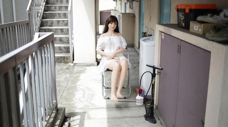 TOKYO, JAPAN - JUNE 25:  Senji Nakajima watches TV with his Love Doll
