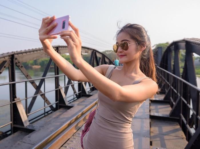 Portrait of young beautiful Asian tourist woman relaxing at Kanchanaburi province in Thailand