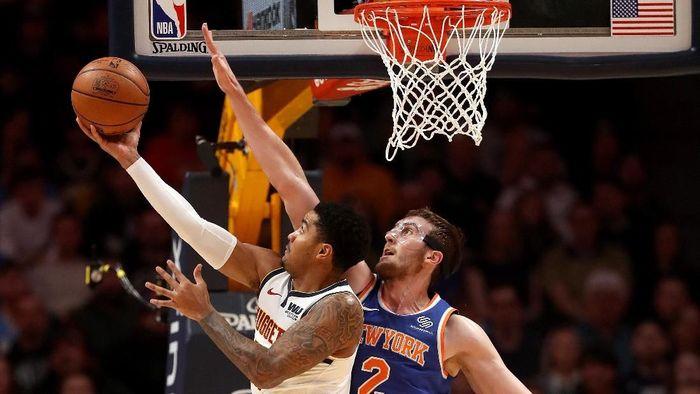 Denver Nuggets mengalahkan New York Knicks dalam lanjutan NBA. Foto: Matthew Stockman/Getty Images