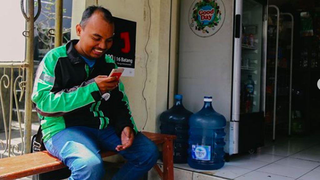 Kerja Keras Torang, Driver Ojol Tunawicara yang Tak Kenal Lelah