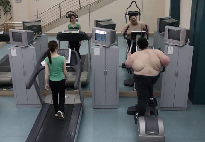Namun dengan kegigihan perlahan Huang mulai menyesuaikan diri. Dalam foto ini ia sedang latihan aerobik. (Foto: China Photos/Getty Images)