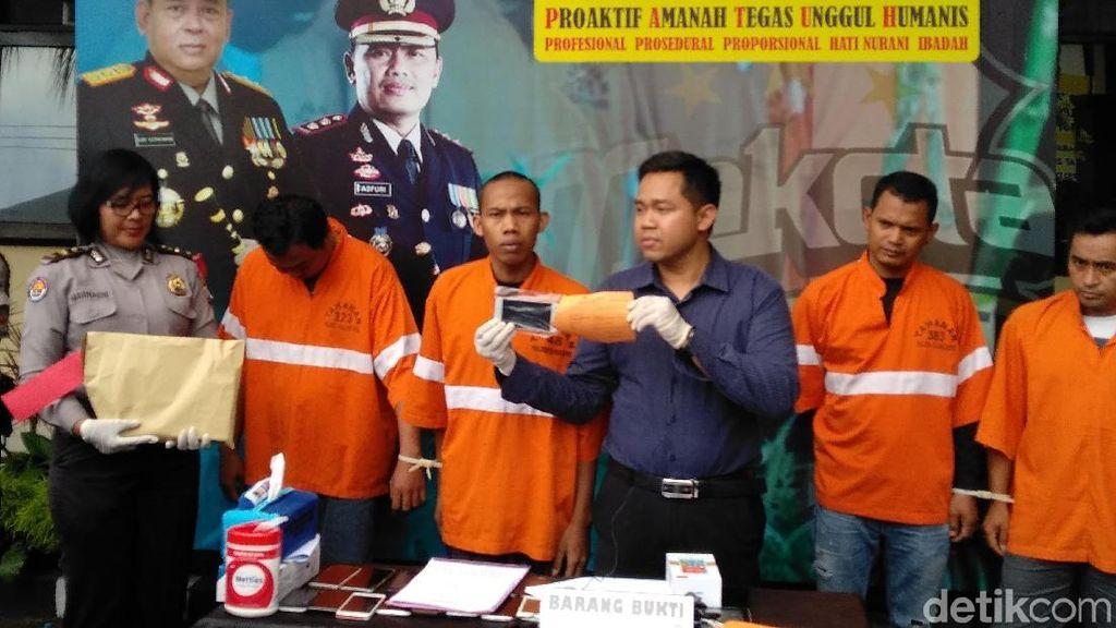 Penadah Kejahatan di Malang Ditangkap, Seratusan HP Disita