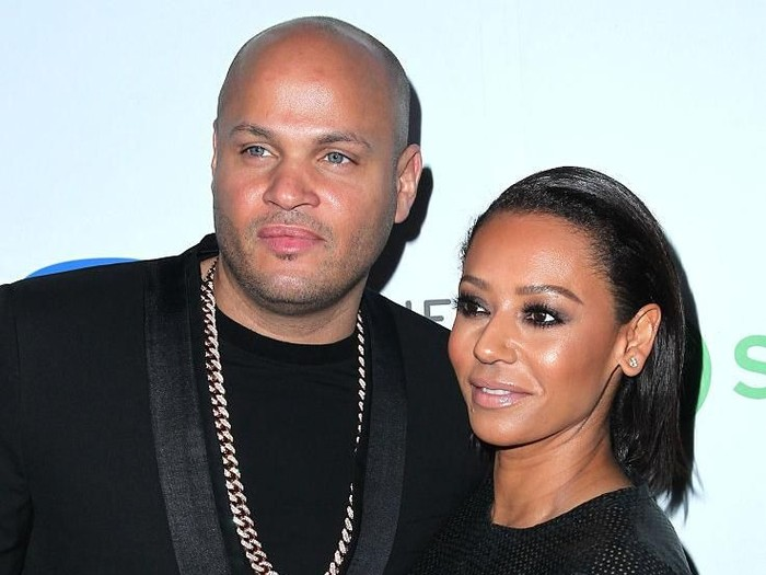 LOS ANGELES, CA - FEBRUARY 08:  Producer Stephen Belafonte (L) and recording artist Melanie Brown attend the Warner Music Group annual Grammy celebration at Chateau Marmont on February 8, 2015 in Los Angeles, California.  (Photo by David Buchan/Getty Images)