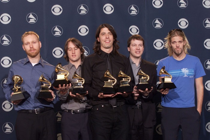 Dave Grohl, center, and the Foo Fighters pose backstage with Grammys they received for Best Rock Album and Best Music Video/Short Form at the 43rd Annual Grammy Awards at Staples Center in Los Angeles Wednesday, Feb. 21, 2001. Photo by Scott Gries/ImageDirect