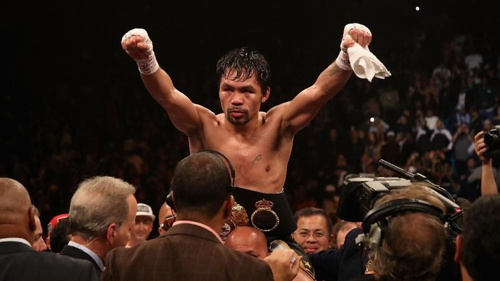LAS VEGAS, NEVADA - JANUARY 19:  Manny Pacquiao celebrates after defeating Adrien Broner by unanimous decision during the WBA welterweight championship at MGM Grand Garden Arena on January 19, 2019 in Las Vegas, Nevada. (Photo by Christian Petersen/Getty Images)