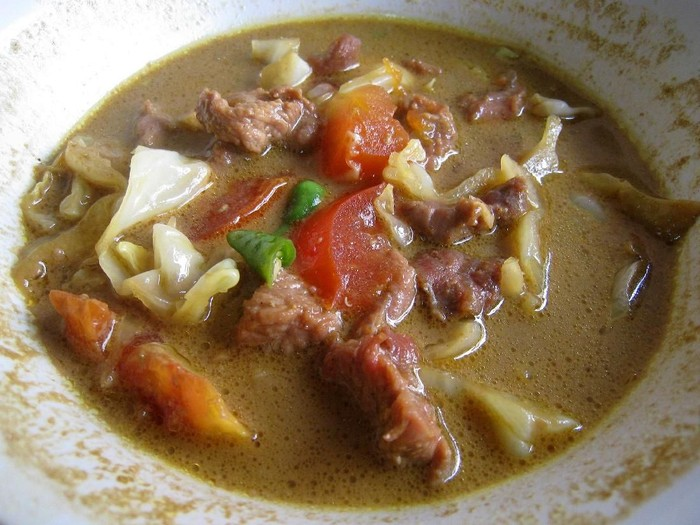 Tongseng, a Javanese spicy and rather sweet goat meat soup. Specialty of Solo (Surakarta), Central Java.
