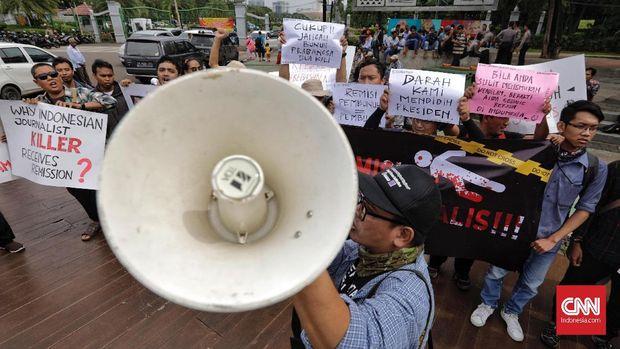 Jokowi Lempar Polemik Remisi Pembunuh Wartawan ke Menkumham