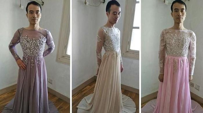 Penjual pria mencoba gaun sebagai contoh untuk pelanggannya. Foto: Dok. Facebook