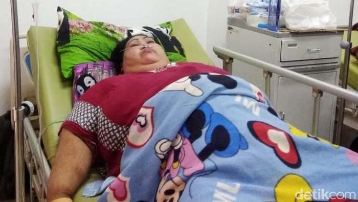 Sunarti yang merasa kesepian karena suami jarang pulang mengalami obesitas. Foto: Luthfiana Awaluddin