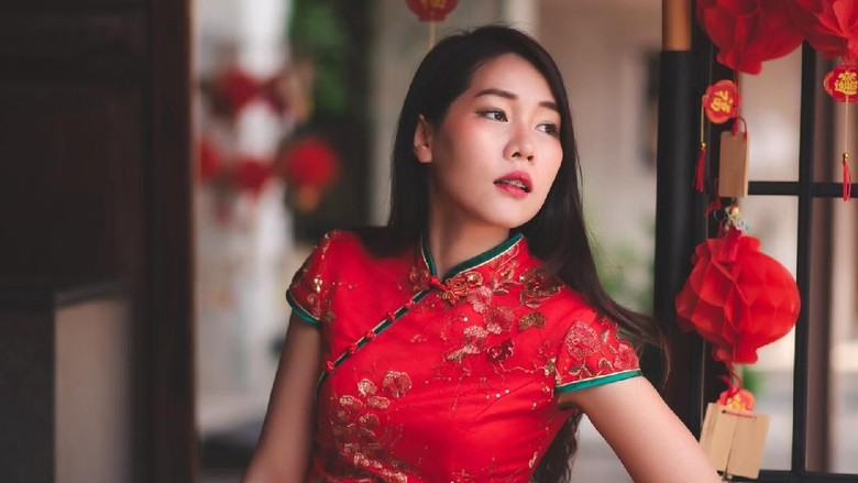 Asian Chinese Woman Wearing Cheongsam Traditional Red Dress Siting on Chair Fashion Posting Chinese New Year