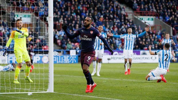 Gol Lacazette menutup kemenangan Arsenal atas Huddersfield.