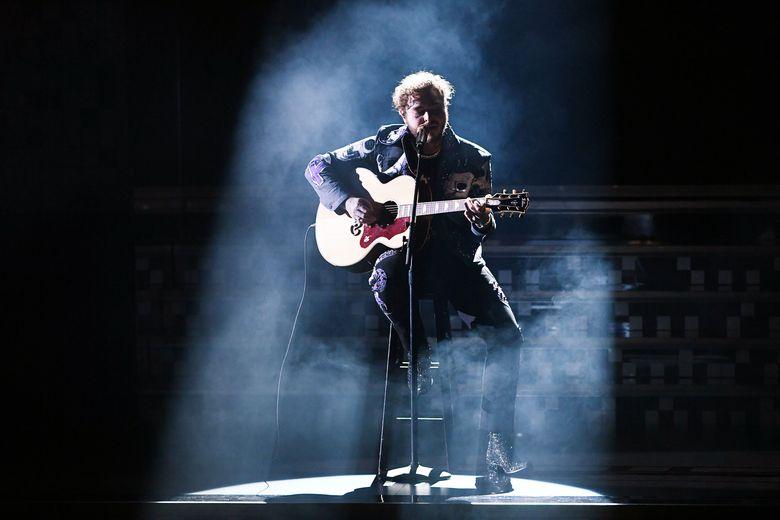 Post Malone tampil terlebih dahulu di Grammy Awards 2019 dengan membawakan lagu Rockstar.Kevin Winter/Getty Images for The Recording Academy