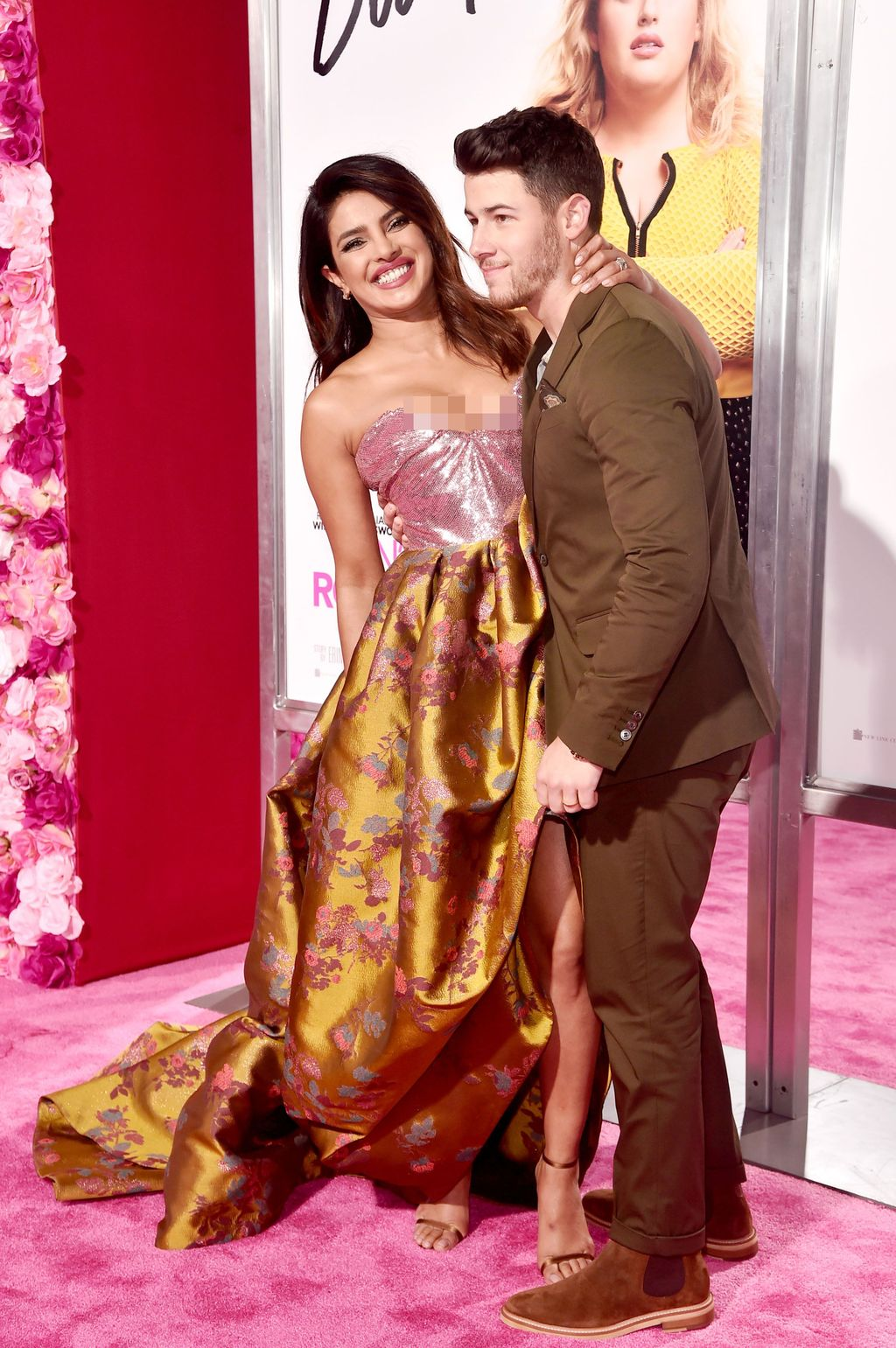 LOS ANGELES, CALIFORNIA - FEBRUARY 11: (L-R) Priyanka Chopra and  Nick Jonas attend the premiere of Warner Bros. Pictures'
