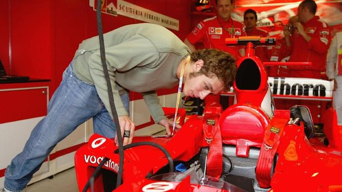 MELBOURNE - MARCH 07:  Valentino Rossi of Italy and Yamaha inspects the 2004 Ferrari at the 2004 Australian Grand Prix, on March 7th, 2004 at the Albert Park Circuit in Melbourne, Australia. (Photo by Clive Rose/Getty Images)