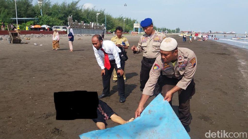 Sesosok Mayat Perempuan Bergamis Hitam Ditemukan di Pantai Tegal