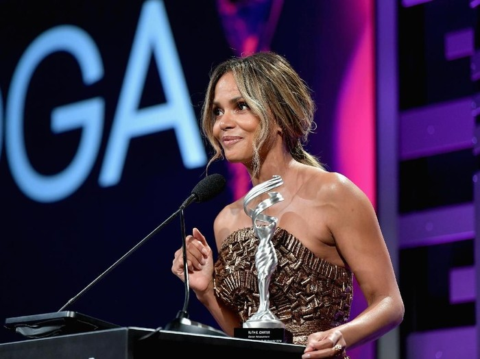 BEVERLY HILLS, CA - FEBRUARY 19:  (L-R) Ruth E. Carter accepts the Career Achievement Award from Halle Berry and Danai Gurira onstage during The 21st CDGA (Costume Designers Guild Awards) at The Beverly Hilton Hotel on February 19, 2019 in Beverly Hills, California.  (Photo by Frazer Harrison/Getty Images)