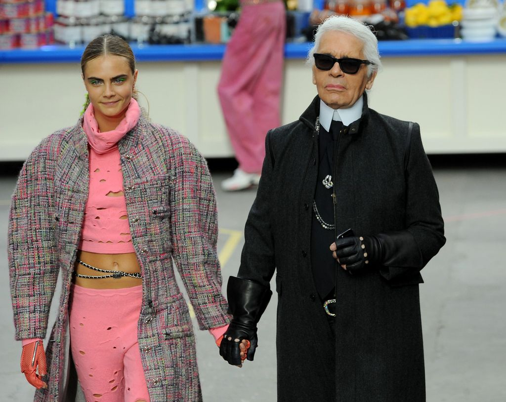 PARIS, FRANCE - MARCH 04:  Fashion Designer Karl Lagerfeld and model Cara Delevingne appear at the end of the runway during the Chanel show as part of the Paris Fashion Week Womenswear Fall/Winter 2014-2015 on March 4, 2014 in Paris, France.  (Photo by Francois Durand/Getty Images)