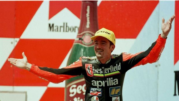 7 Apr 1996:  Max Biaggi shrugs his shoulders after finishing second in the 250cc Indonesian Motorcycle Grand Prix at Sentul, Jakarta.  Mandatory Credit: Mike Cooper/ALLSPORT