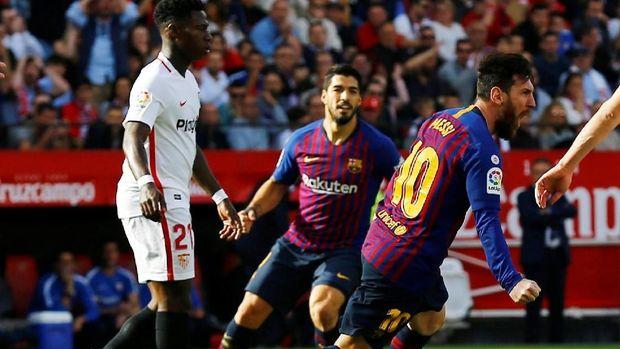 Lionel Messi mencetak hattrick ke gawang Sevilla. (