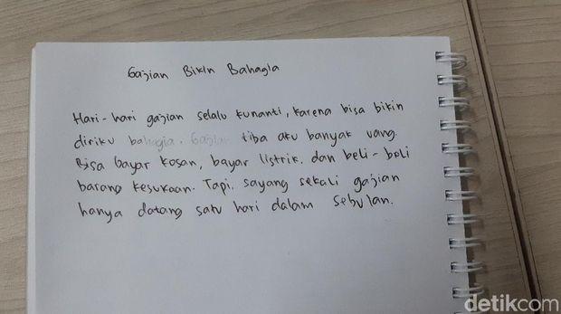 Contoh tulisan tangan Anggi.