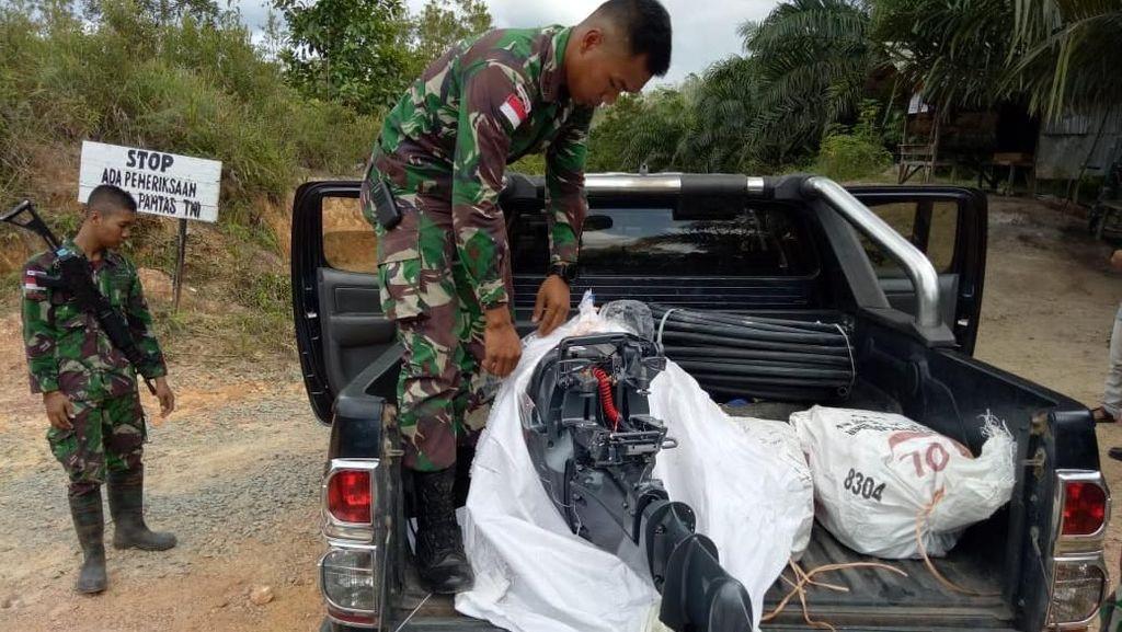 TNI Penjaga Lintas Batas RI-Malaysia Amankan Penyelundupan Mesin Kapal