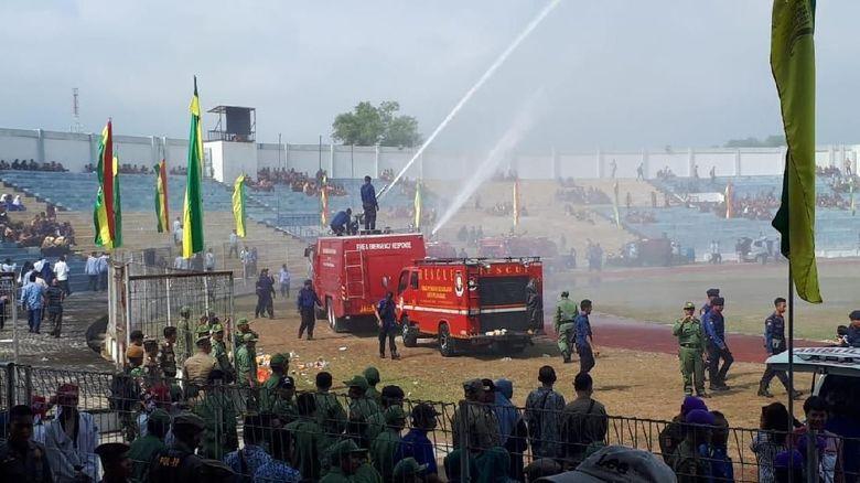 Image result for mendagri tjahjo kumolo jadi inspektur upacara HUT Damkar di Pekanbaru