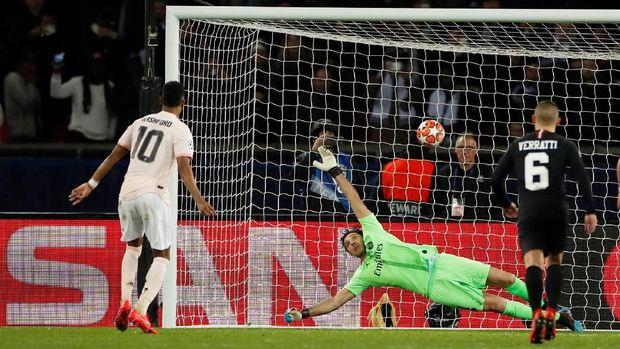 Penalti Marcus Rashford memastikan langkah Man United ke perempat final Liga Champions.