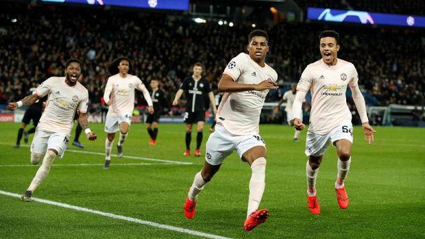 Marcus Rashford merayakan gol penalti ke gawang PSG.