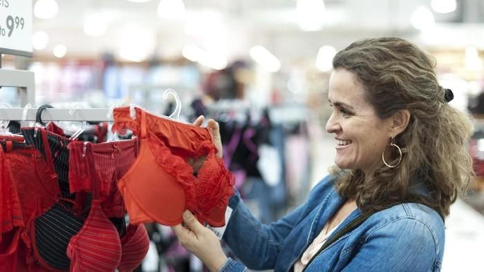 Woman in underwear store indoors horizontal shot.