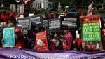 Potret Aksi Hari Perempuan di Kawasan Monas