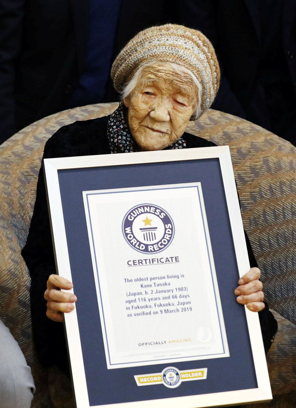116-year-old Japanese woman Kane Tanaka holds a Guinness World Records certificate naming her as the world's oldest person living during a ceremony in Fukuoka, Japan March 9, 2019.  Mandatory credit Kyodo/via REUTERS ATTENTION EDITORS - THIS IMAGE WAS PROVIDED BY A THIRD PARTY. MANDATORY CREDIT. JAPAN OUT. NO COMMERCIAL OR EDITORIAL SALES IN JAPAN.