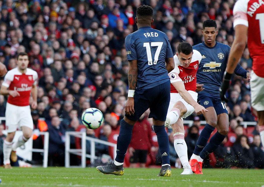Arsenal menang 2-0 atas Manchester United dalam lanjutan Premier League. Granit Xhaka mencetak satu gol dengan tendangan geledeknya dari luar kotak penalti (John Sibley/Reuters)
