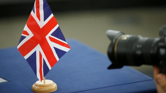 The British Union Jack flag is seen on the desk of a member of the European Parliament ahead of a debate on the future of Europe, at the European Parliament in Strasbourg, France, March 12, 2019. REUTERS/Vincent Kessler