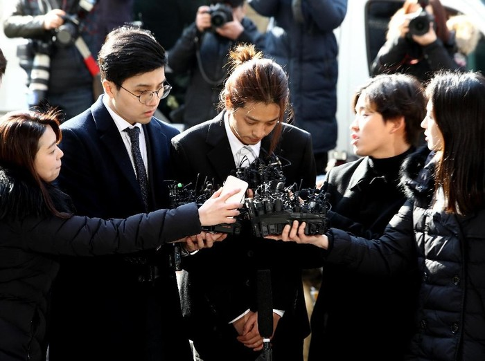 SEOUL, SOUTH KOREA - MARCH 14: Singer Jung Joon-young is seen arriving at a Seoul Metropolitan Police Agency on March 14, 2019 in Seoul, South Korea.  Jung Joon-young, a South Korean singer-songwriter and TV celebrity appeared at the police station on Thursday to be questioned over suspicions of sharing sexual videos in a group chat which included BIGBANGs member Seungri, who is facing charges of supplying prostitution services.  (Photo by Chung Sung-Jun/Getty Images)
