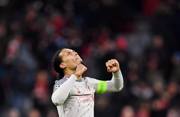 Liverpool menang atas Bayern Munich, 3-1 di lanjutan babak 16 besar Liga Champions. Virgil Van Dijk mencetak 1 gol kemenangan (Andreas Gebert/Reuters)