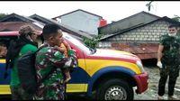 Melihat Aksi Prajurit TNI Gendong Lansia Korban Banjir Sentani