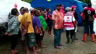 Senyum Lebar Korban Banjir Sentani saat Terima Bantuan PMI