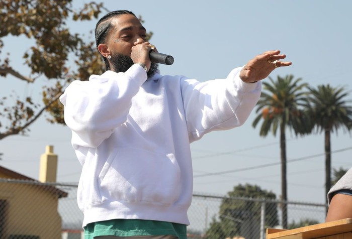 LOS ANGELES, CA - OCTOBER 22:  Nipsey Hussle speaks to kids at the Nipsey Hussle x PUMA Hoops Basketball Court Refurbishment Reveal Event on October 22, 2018 in Los Angeles, California.  (Photo by Jerritt Clark/Getty Images for PUMA)