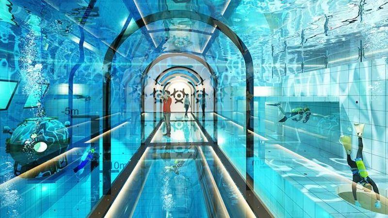 Sebuah kolam terdalam di dunia akan dibuka di Polandia akhir tahun ini. Kolam renang ini lengkap dengan gua-gua bawah laut yang menggantung dan kedalamannya mencapai 45 meter (Deepspot/CNN Travel)