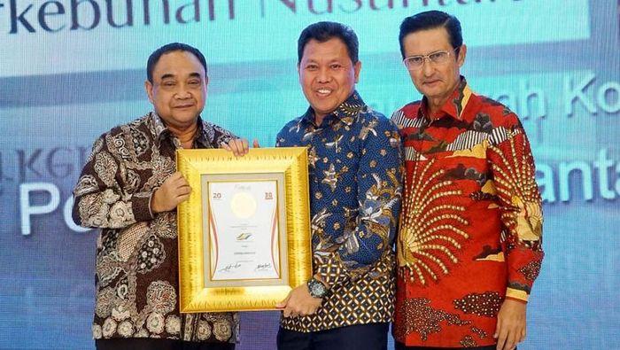 Direktur Utama Perkebunan Nusantara Dolly Pulungan (tengah)/Foto: dok. PTPN