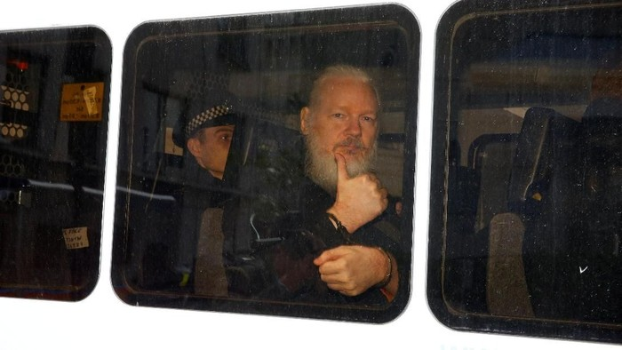 FILE PHOTO: WikiLeaks founder Julian Assange is seen in a police van after was arrested by British police outside the Ecuadorian embassy in London, Britain April 11, 2019. REUTERS/Henry Nicholls/File Photo