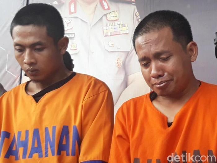 Dua tersangka pembunuhan dan mutilasi mayat dalam koper. Foto: Hilda Meilisa Rinanda