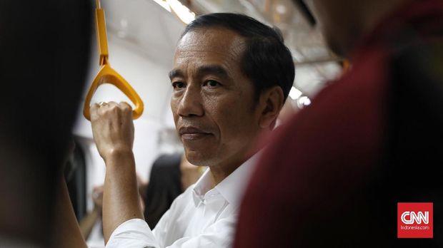 Membangkitkan Orde Baru Lewat Tim Pantau Pencaci Jokowi