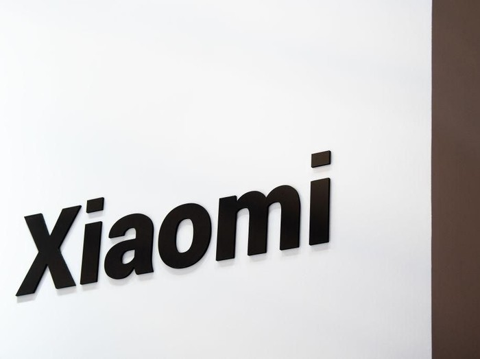 BARCELONA, SPAIN - FEBRUARY 26:  A logo sits illumintated outside the Xiaomi booth on day 2 of the GSMA Mobile World Congress 2019 on February 26, 2019 in Barcelona, Spain. The annual Mobile World Congress hosts some of the worlds largest communications companies, with many unveiling their latest phones and wearables gadgets like foldable screens and the introduction of the 5G wireless networks. (Photo by David Ramos/Getty Images)