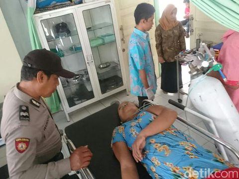 Sunarsih (42) terbaring/istimewa